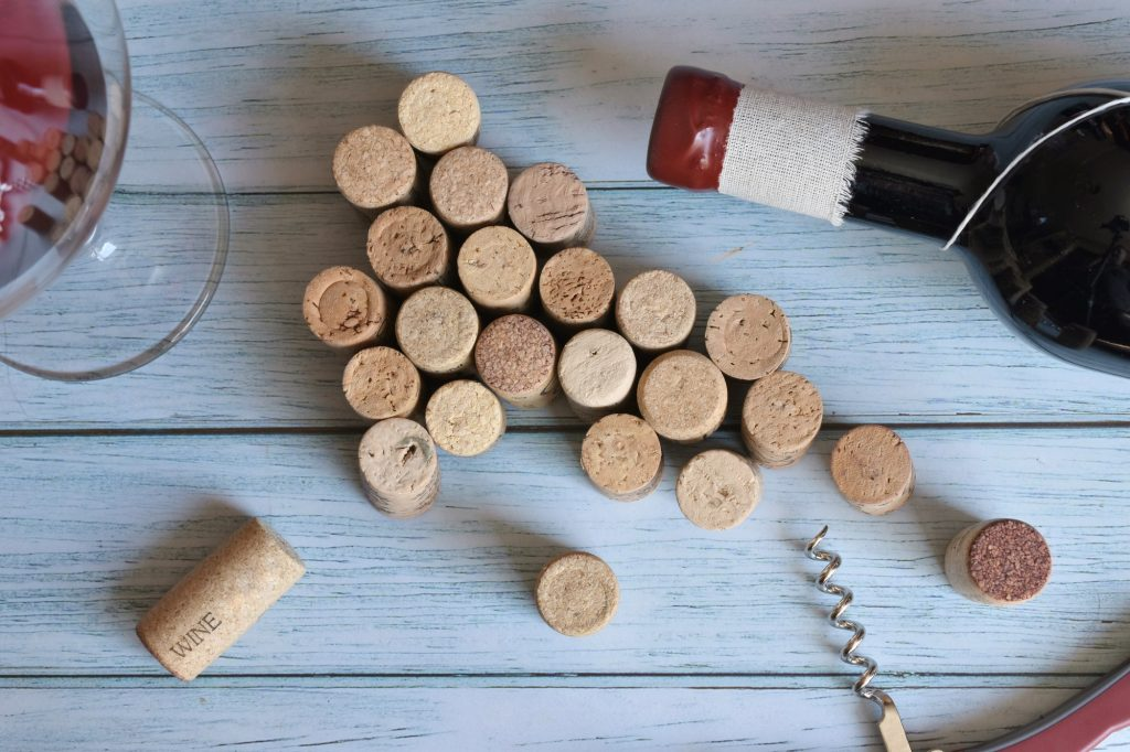 Wine corks and a glass of wine